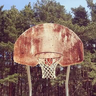 well-used outdoor basketball hoop