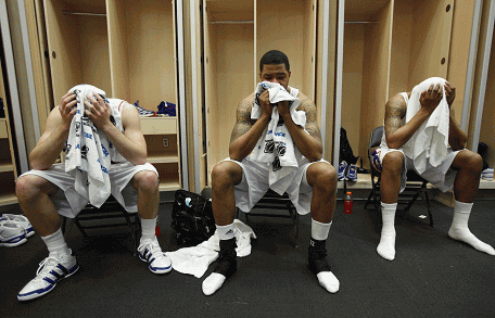 a sad locker room after the final loss